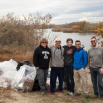 Club advisor Gretchen Graber, left, club officer Randy Bartoshevich, club president Elinor Lake and other club members and volunteers on Bateman Island during the cleanup.