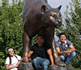CAMP students with Cougar Statue