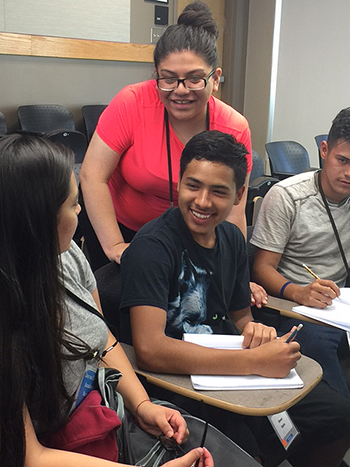 Gizelle Sandoval, center, works with high school participants in Dare to Dream