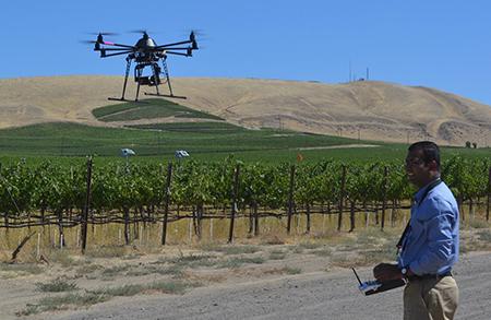 Lav Khot, WSU researcher, testing ag drone