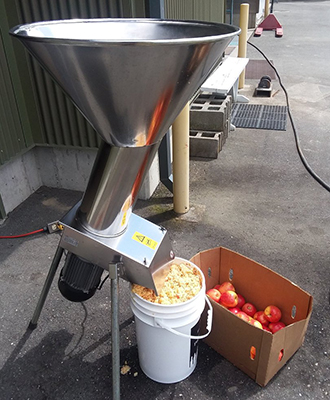 Transportable cider press in action (WSU Photo)