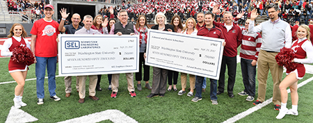 Schweitzer endowment presentation at WSU vs. Nevada-Reno football game, Sept. 23
