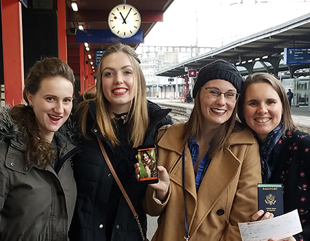 "WSU Global Competition team ""Dignity Before Detention"" at train station."