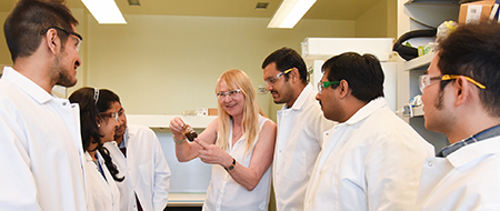 Birgitte Ahring, left, with his research team
