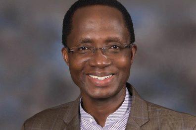 Portrait of Dr. M. Kariuki Njenga