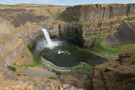 The Palouse River in southeastern Washington State drops nearly 200 feet through cliffs of basalt created by scores of lava flows 10 to 16 million years ago. WSU researchers have determined that one flow constituted one of the Earth's largest known volcanic eruptions, a millennia-long spewing of sulfuric gas that blocked out the sun and cooled the planet. Photo by Dean Hare, WSU Photo Services.
