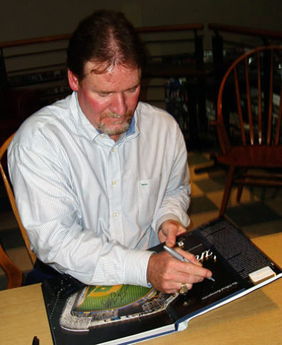 """ampa Bay Devil Ray Wade Boggs autographing the book """"Yankee Stadium"""" at a book signing on September 23, 2008. Photo courtesy of Wikimedia Commons."""