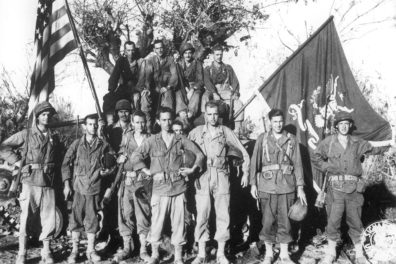 Members of the 161st with the U.S. flag and regimental colors. Photo was taken in the Pacific Theater at an unknown location sometime between 1943 and 1945. Image courtesy of the National Guard Museum, Camp Murray, Washington.