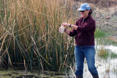 Katherine Strickler, a research associate in the School of the Environment, samples water in a search for minute amounts of DNA that could signal the presence of at-risk species.