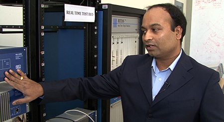 Anurag Srivastava with smart grid test equipment