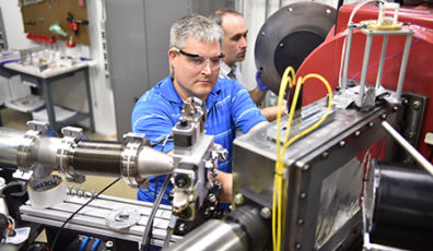 Stefan Turneaure, first author, prepares the target chamber for a shotDynamic Compression Sector at Argonne National Labs Advanced Photon Source.