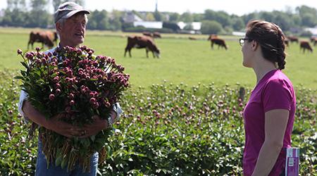 WSU plant pathology graduate Andrea Garfinkel talks with peony grower.