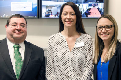 Robert Playo, left, with Clinical Assistant Professor Dana Dermody, center, and Megan Weese, right