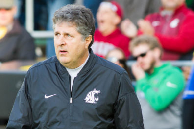 Close up of Mike Leach observing the field.