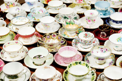 Various types of teacups sitting on a table next to each other