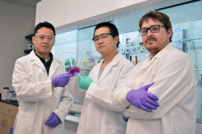 Ming and his colleagues Wei Chen, assistant research professor, and Jacob Day, Ph.D. student, chemistry in a lab.