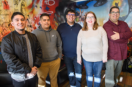 WSU Spanish translation team: far right, Brian Dixon, assistant VP of WSU's student financial services, with his team of students and a staff member who translated the website into Spanish. Left to right: Jose Alejandro Garcia, Alejandro Brito, Ramiro Mora, Carmen Kroschel. (Photo by Robert Hubner, WSU Photo Services)