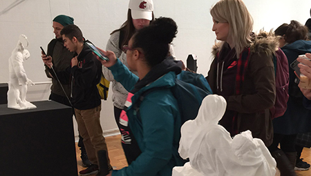 Students look at electronically generated sculpture