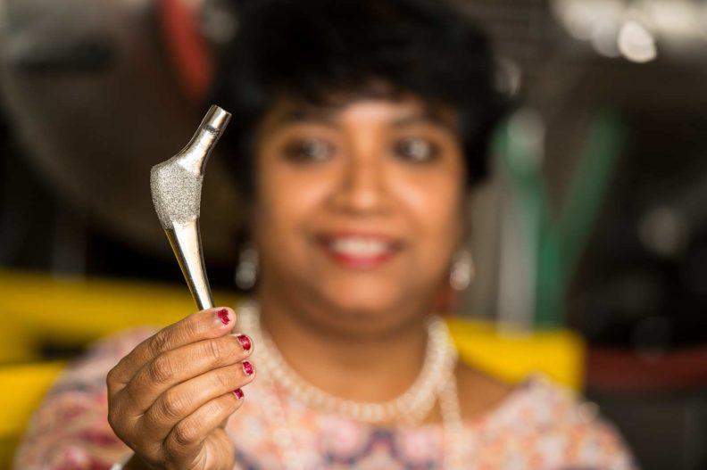 Susmita Bose examining a 3-d imprinted bone implant.