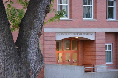 Front entrance of Todd Hall with Carson College of Business above the door.