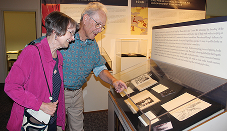 WSU professor emerita of English Diane Gillespie and husband Dick Domey look over books in the Hogarth Press book collection in Manuscripts, Archives and Special Collections. Photo by Nella Letizia.