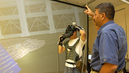 Professor Jayaram Sankar Works with a Student in the Virtual Reality Computer Integrated Manufacturing Laboratory.