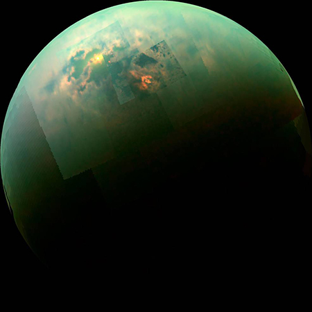 Sunlight glints off of Titan's northern seas this near-infrared, color mosaic from NASA's Cassini spacecraft. Photo by NASA/JPL/Univ. Arizona/Univ. Idaho