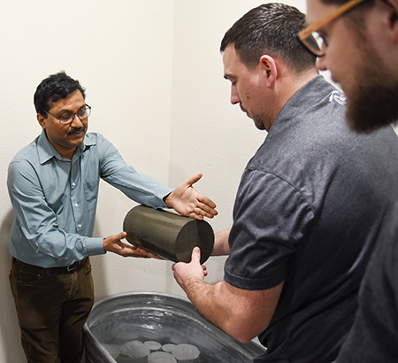 Srinivas Allena (left) clinical associate professor of civil and environmental engineering, discuss concrete testing methods