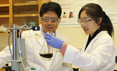 Yuehe Lin (left) and Shaofang Fu, a WSU Ph.D. student, in WSU Lin's materials engineering lab.