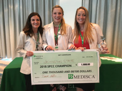WSU student pharmacists Shauna Leggett, Katie Cashman, and Megan Baker with award for winning 2018 national compounding contest