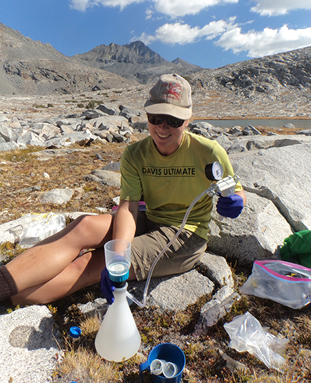 Colleen Kamoroff collects eDNA samples for analysis in Sequoia Kings Canyon National Park. Photo by Jessica Thompson.