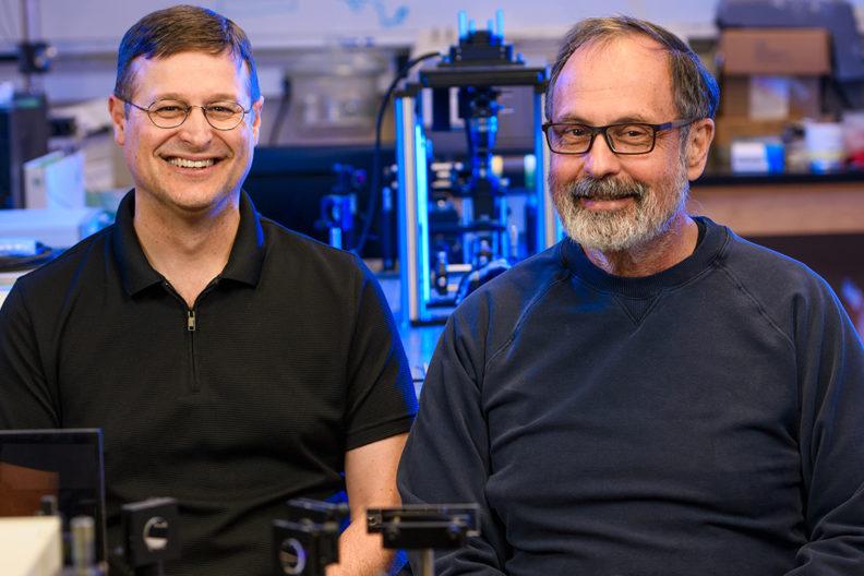 Brozik and Hipps (l-r), WSU chemistry scientists, seek to develop molecular machines that self-replicate materials. Photo by Robert Hubner, WSU Photo Services.