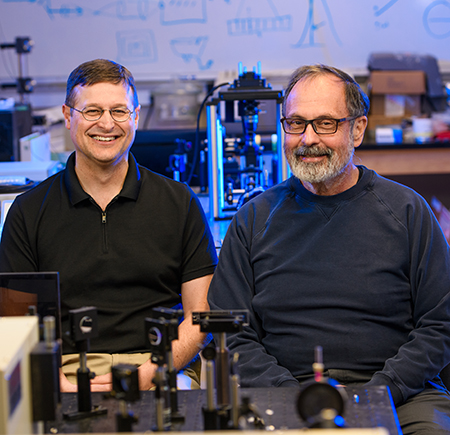 Brozik and Hipps (l-r), WSU chemistry scientists, seek to develop molecular machines that self-replicate materials. Photo by Robert Hubner, WSU Photo Services.