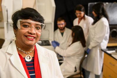 Susmita Bose standing in a laboratory