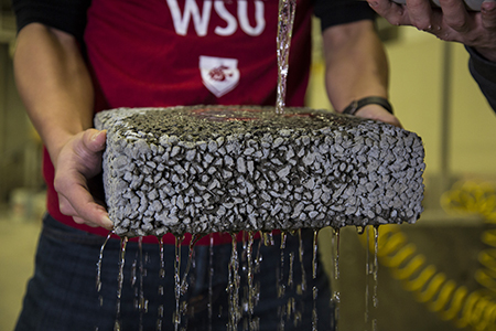 Water runs through WSU pervious pavement in test.