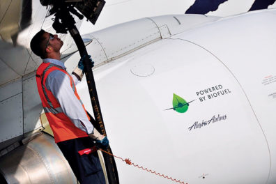 A passenger jet being filled with biofuel.