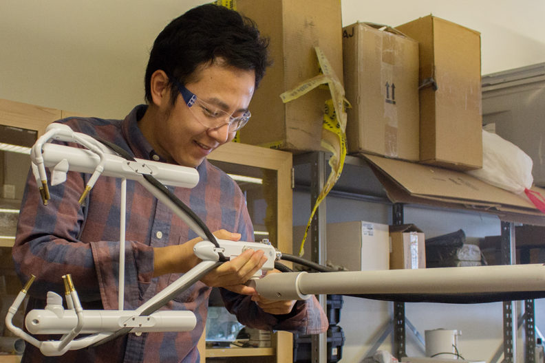 Postdoctoral researcher Zhongming Gao prepares atmospheric measurement instrumentation as part of a new USDA-funded project to study sustainable farming practices in the face of climate change.