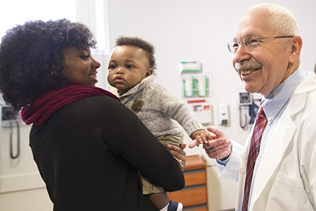Infectious disease specialist Dr. George Novan, WSU's Elson S. Floyd College of Medicine, meets with patients. (Photo by Cori Kogan, WSU Spokane Communications)