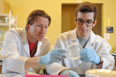 Anders Omsland, assistant professor, Paul G. Allen School of Global Animal Health, and Goldwater scholar Zachary Howard (l-r)