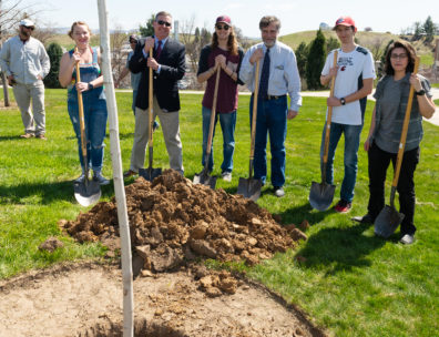 Members of the Washington State University Horticulture Club and President Kirk Schulz holding shovels after planting a Red Maple tree.