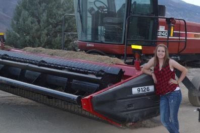 Katie Doonan with swather in field.