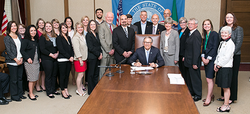 Gov. Jay Inslee signs Engrossed Substitute Senate Bill No. 5557,relating to services provided by pharmacists, on May 11, 2015.