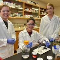 Schweitzer Scholar Raquel Murillo flanked by lab partners at WSU Pullman.