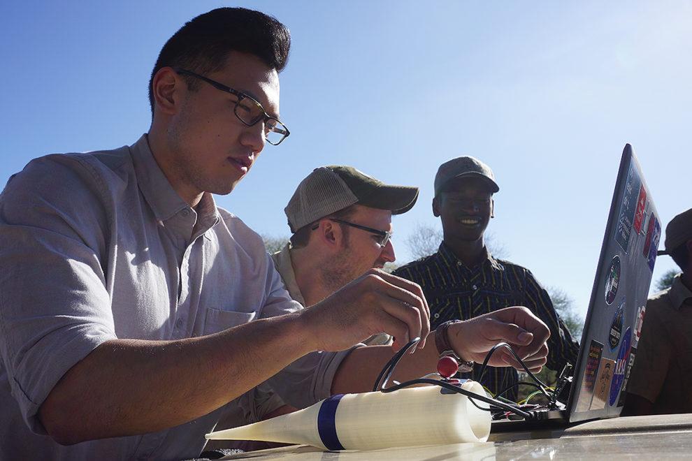 Three team members looking at data.