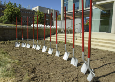 Ceremonial shovels wedged into dirt