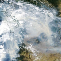 aerial view of Washington with blanket of smoke over it