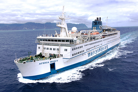 The Africa Mercy cruising at sea.