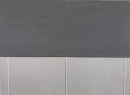 Rectangular tiles in dark and light grey.