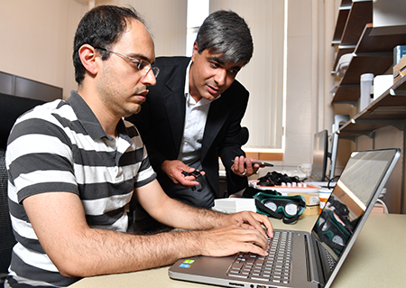 Seyed Ali Rokni and Hassan Ghasemzadeh work together at computer.