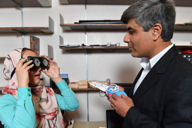 Ghasemzadeh observes research student Nourollahi as she tests a special pair of goggles.